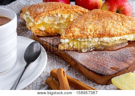 Puff pastry Turnovers apple cake dessert with whipped cream and hot coffee
