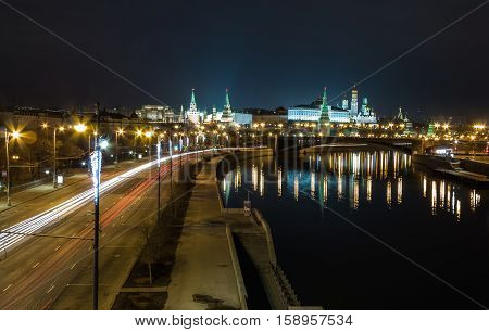 Moscow Kremlin at night. Bridge over the Moscow river. The Moscow river embankment. Moscow Kremlin is a UNESCO World Heritage Site. Color photo.