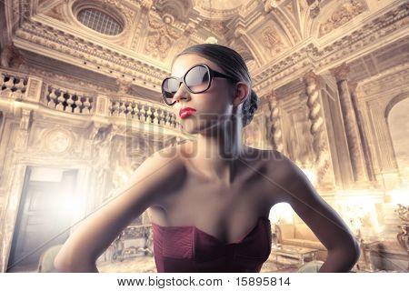 Beautiful elegant woman in a luxury hotel