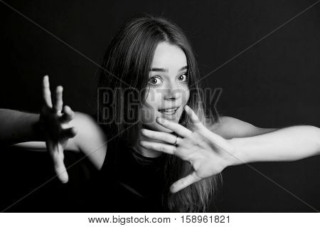 Young beautiful girl makes magical passes with his hands. BW