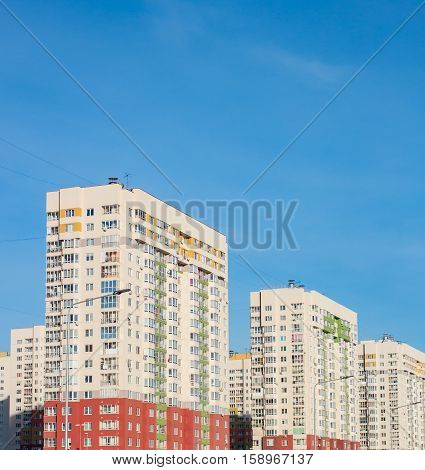 Condominium in the city on a clear day. Town