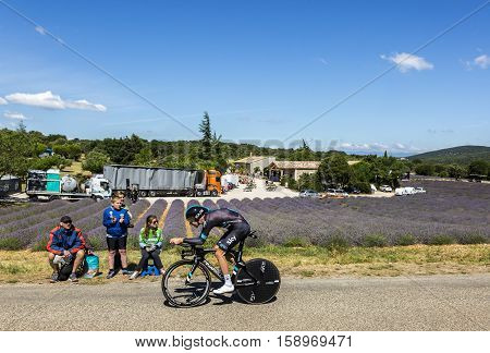 Les ArredonsFrance - July 152016: The British cyclist Luke Rowe of Team Sky riding during an individual time trial stage near a field of lavanda in Ardeche Gorges during Tour de France 2016.