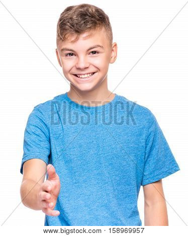 Half-length emotional portrait of caucasian teen boy wearing blue t-shirt, handshake gesturing. Funny teenager with open hand ready for handshake, isolated on white background. Handsome happy child putting out his hand for shaking.