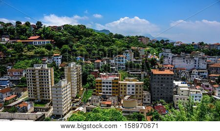 Beautiful view of typical residential houses in the neighborhood of Santa Teresa and blue sky at hot, sunny day in Rio de Janeiro, Brazil poster