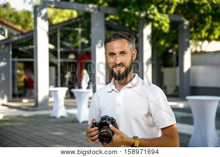 event wedding photographer with camera in hands, Beard and smile