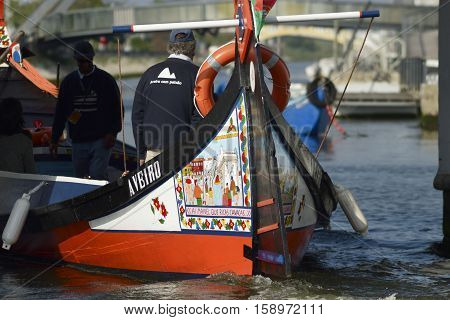 AVEIRO, PORTUGAL - May, 2016: Traditional Moliceiro boats on the canal in central Aveiro, Portugal.
