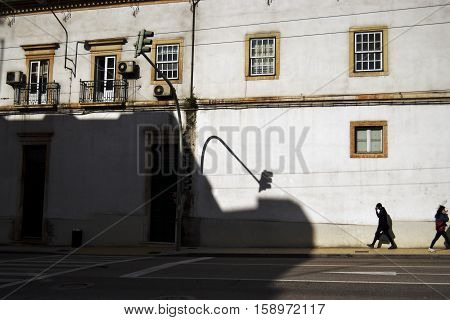 COIMBRA, PORTUGAL - 2016: People in the street in the centre of the ancient university city of Coimbra, Portugal.