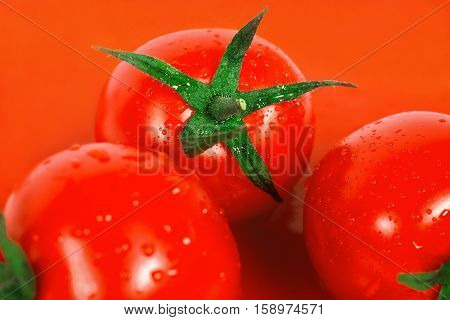 Ripe and red tomatoes are in tomato juice. Tomatoes, droplets of fresh water