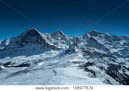 Spectacular winter scenery in the Swiss Alps with famous Eiger, Mönch & Jungfrau in the background, Bernese Oberland, Switzerland.