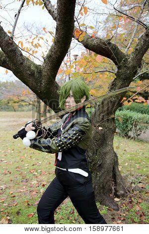 Marugame, Kagawa, Japan -  November 20, 2016: Young japanese girl dressed in cosplay costume at Mamugame-Jou Park. Photo taken in Marugame Cosplay Convention