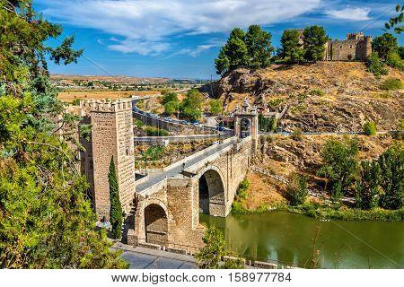 View of the Alcantara Bridge in Toledo, Spain