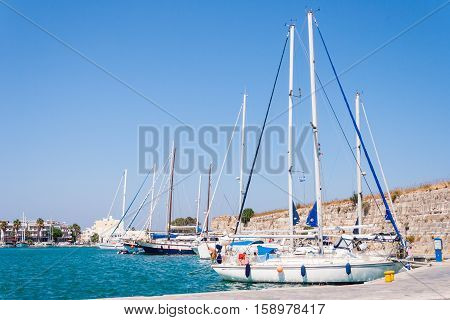 Beautiful view of yachts and harbour in Greece in sunny day. Kos Tows, Kos Island, Greece