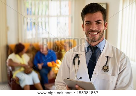 Portrait of young doctor at work as physician in hospital for seniors. Man working in hospice with elderly people health care professional poster