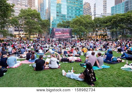 NEW YORK,USA - AUGUST 22,2016 : Newyorkers and tourists enjoying the Bryant Park Summer Film Festival