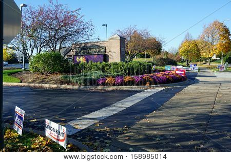 JOLIET, ILLINOIS / UNITED STATES - NOVEMBER 8, 2016: Lawn signs endorse various candidates outside the Wesmere Country Club Clubhouse, which serves as a polling place on election day.