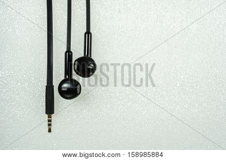 Black Earphone or earphones on white background the Black earphones for using digital music or smart phone