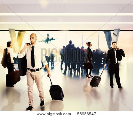 Busy businesspeople waiting at the airport for their flight