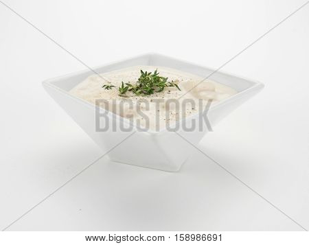 Clam Chowder in Square Bowl on White
