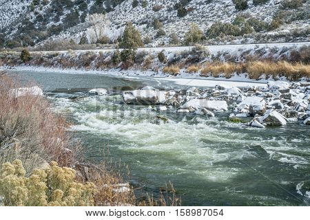 Rodeo Rapid on the upper Colorado River at Burns, Colorado, USA, looking upstream, winter scenery