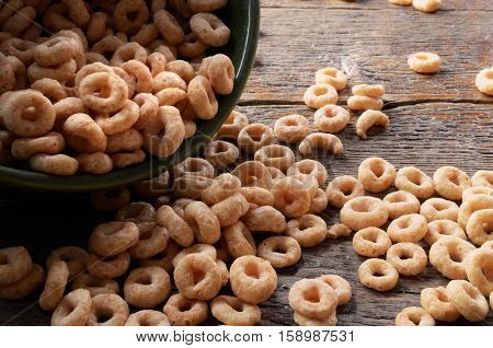 A low angle image of a spilt bowl of cereal.