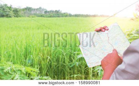 Man reading map in garden concept travel.