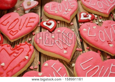 Festive cookies decorated with pink sugar mastic