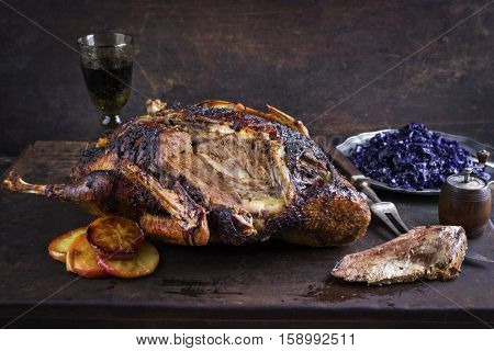 Roast Goose with Orage Slices and Blue Kraut on old Metal Sheet