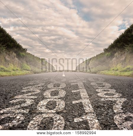 transition between year 2016 and year 2017 painted on asphalt road