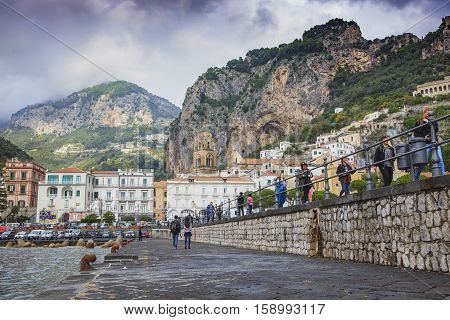 DUOMO AMALFI ITALY - NOVEMBER 5 : tourist walking on walking way of amalfi pier amalfi town important histolic traveling landmark in south italy on november 5 2016 in amalfi town south italy