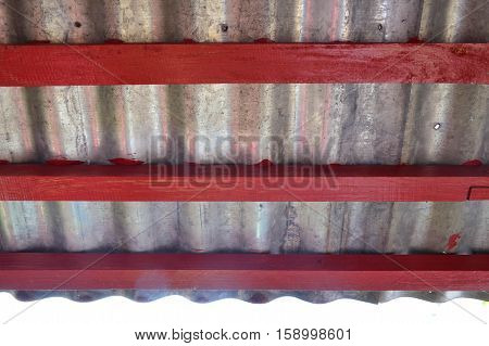 Under Zinc Eaves Roof With Red Wood