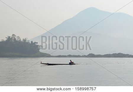 Boatman Sailing Motorboat In The River Cloudy View