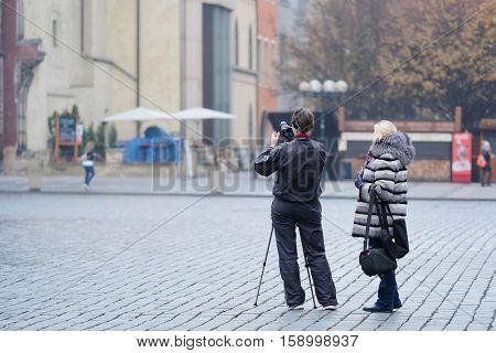Prague, Czechia - November, 21, 2016: tourast shoots on Old Town Square in the center of Prague, Czechia