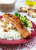Maple glazed salmon with caramelized onions served with rice poster