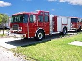 Brand new shiny red fire engine right off the assembly line in Ocala Florida. poster