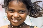 portrait of a laughing girl tamil nadu india. poster