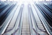 Escalator blurred with motion, high key image poster