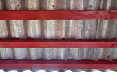 Under Zinc Eaves Roof With Red Wood poster
