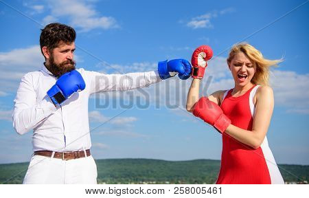 Relations As Struggle Concept. Man And Woman Fight Boxing Gloves Blue Sky Background. Defend Your Op