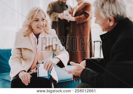 Couple With Tickets In Airport In Waiting Room. Senior Person In Airport. Tourism Concept. Airport T