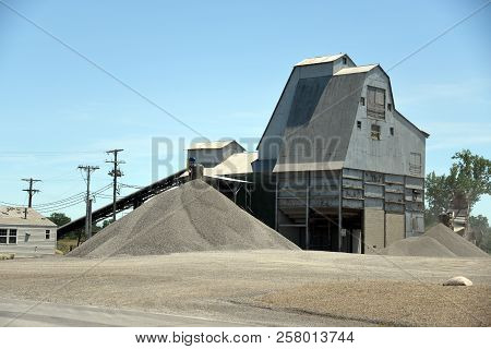 Stone Quarry With Conveyor Belts And Piles Of Stones. Belt Conveyors And Mining Equipment In A Quarr