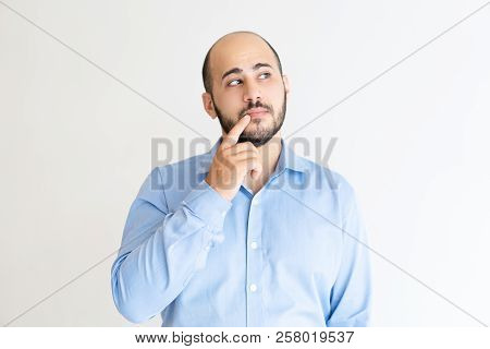Sly Man Touching Mouth With Finger And Looking Away. Handsome Guy Thinking. Contemplation Concept. I