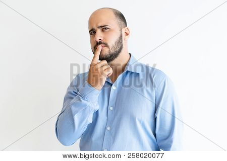Thoughtful Man Touching Mouth With Finger And Looking Away. Handsome Guy Thinking. Contemplation Con