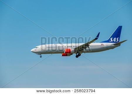 Zurich, Switzerland - July 19, 2018: Scandinavian SAS airlines airplane preparing for landing at day time in Zurich nternational airport