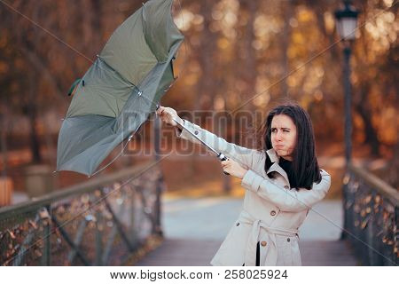 Girl Fighting The Wind Holding Umbrella Raining Weather
