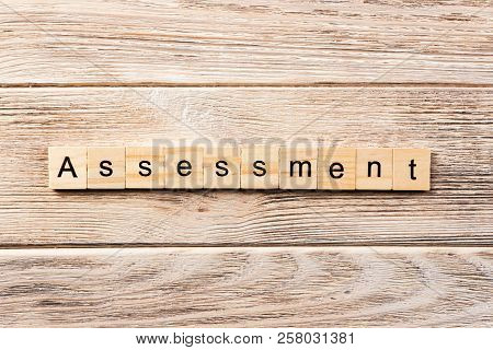 Assessment Word Written On Wood Block. Assessment Text On Table, Concept.