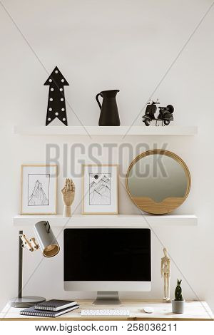 Wall Shelves With Decor And Simple Posters Above Wooden Home Office Desk With Metal Lamp, Mockup Mon