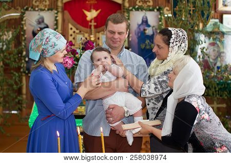 Belarus, The City Of Gomel, June 2, 2018. Zyabrovskaya Church. Baptism Of The Child. Parents And God