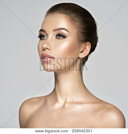 Beautiful young woman - profile view.. Beauty treatment concept. Portrait of a pretty  caucasian girl with healthy skin.