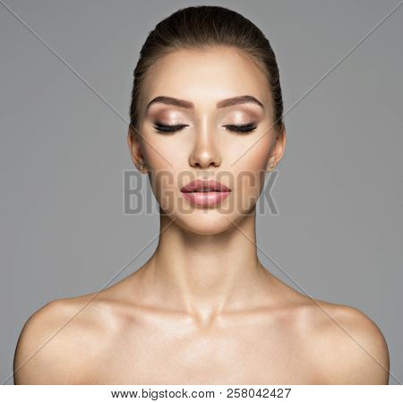 Calm face of  beautiful young woman. Beauty treatment concept. Portrait of a pretty  caucasian girl with healthy skin.