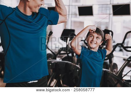 Young Father And Son Preparing For Training In Gym. Healthy Lifestyle Concept. Sport And Training Co